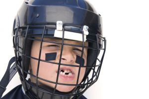 Boy in football helmet with missing teeth