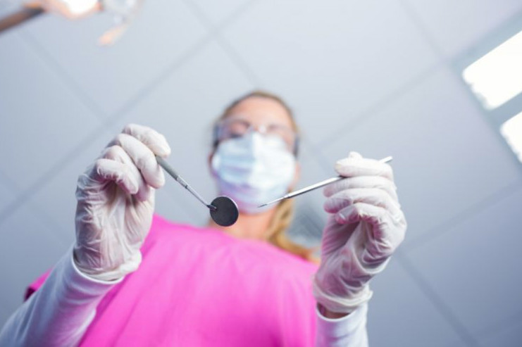 Dentist holding tools in hand - Dental Anesthesia Fairfield, CA