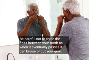 Older man flossing teeth in front of mirror, with text - Fairfield, CA