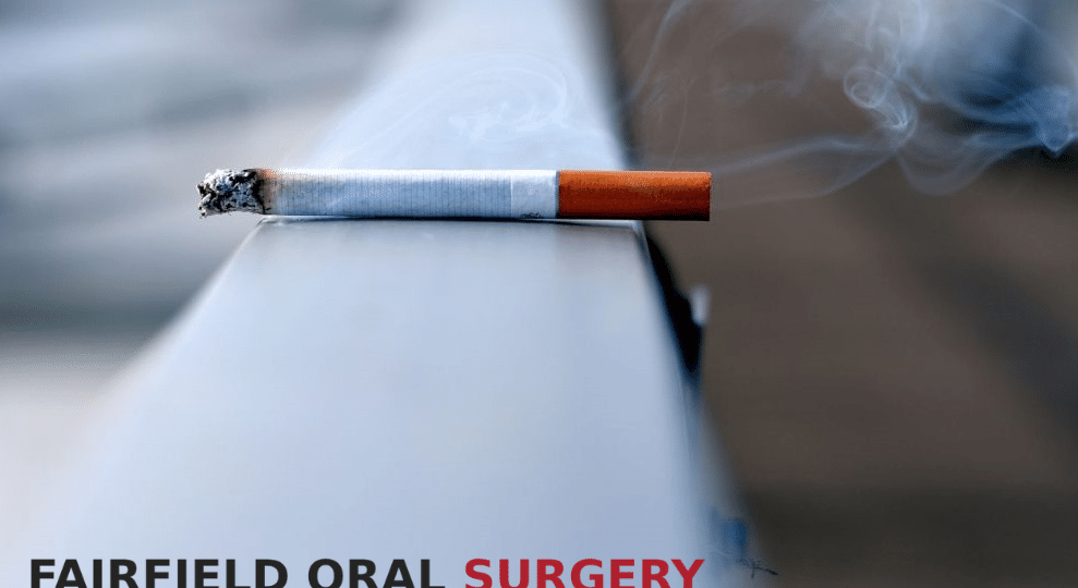 Cigarette lying on a ledge because of smoking and oral cancer - Fairfield, CA