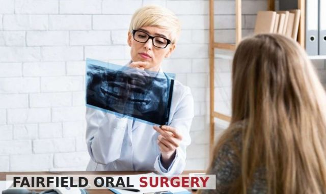 Female dentist looking at patient R-ray for Gingivitis - Fairfield, CA